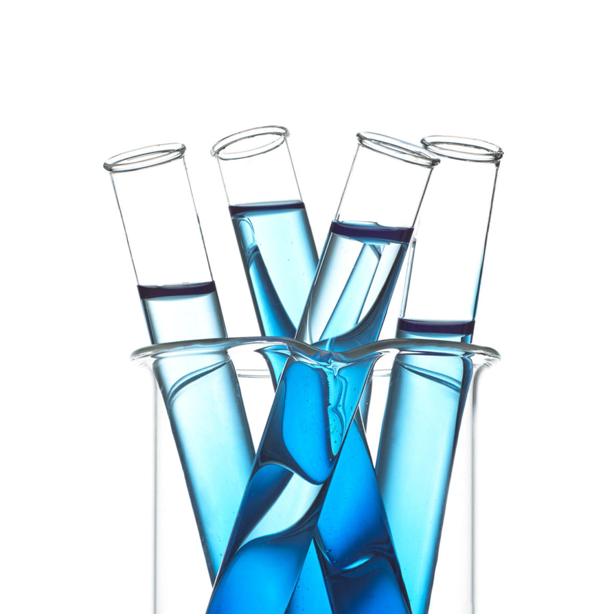 Four test tubes filled with blue liquid.